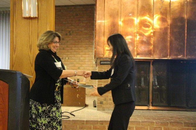 Dean Kaynama congratulates outstanding scholarship award recipient Yingying Shao