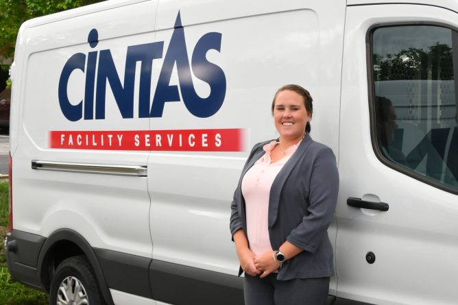 Jillian Ayd standing in front of a Cintas van