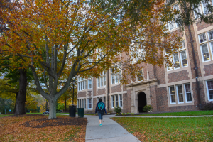 a student walking towards the side entrance of Stephens Hall