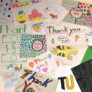 collage of hand-drawn thank you notes from children