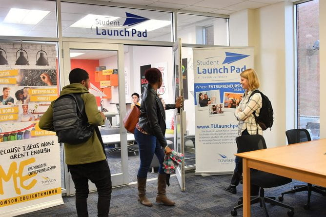 Students enter the Student Launch Pad in Cook Library