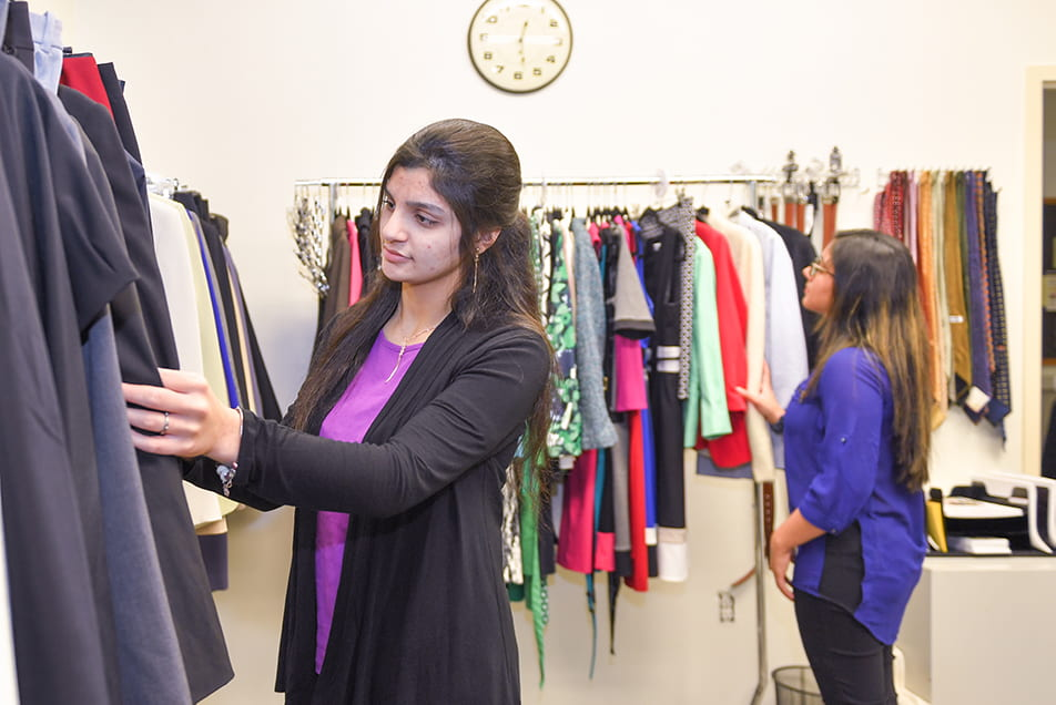 students browse suits in the new well-suited wardrobe