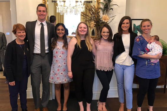 group of scholarship recipients pose after having lunch together