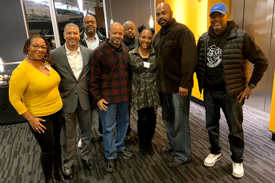cbe alumni gather at the annual hoops and handshakes event at the TU men's basketball game