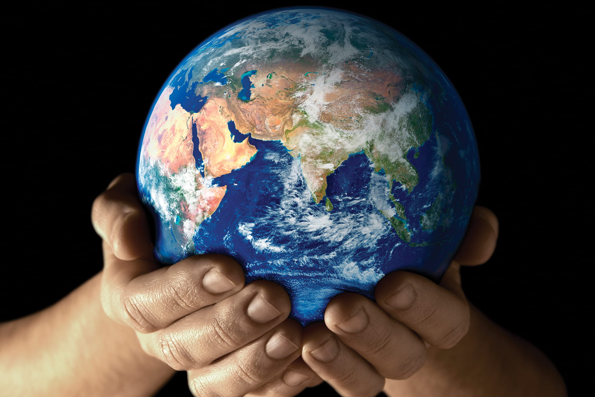 hands cradling the planet earth