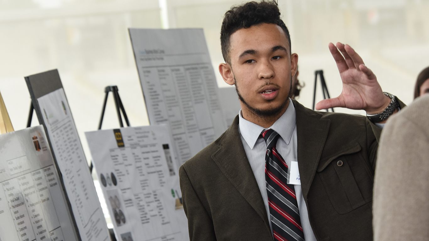 a student gives a pitch to a judge