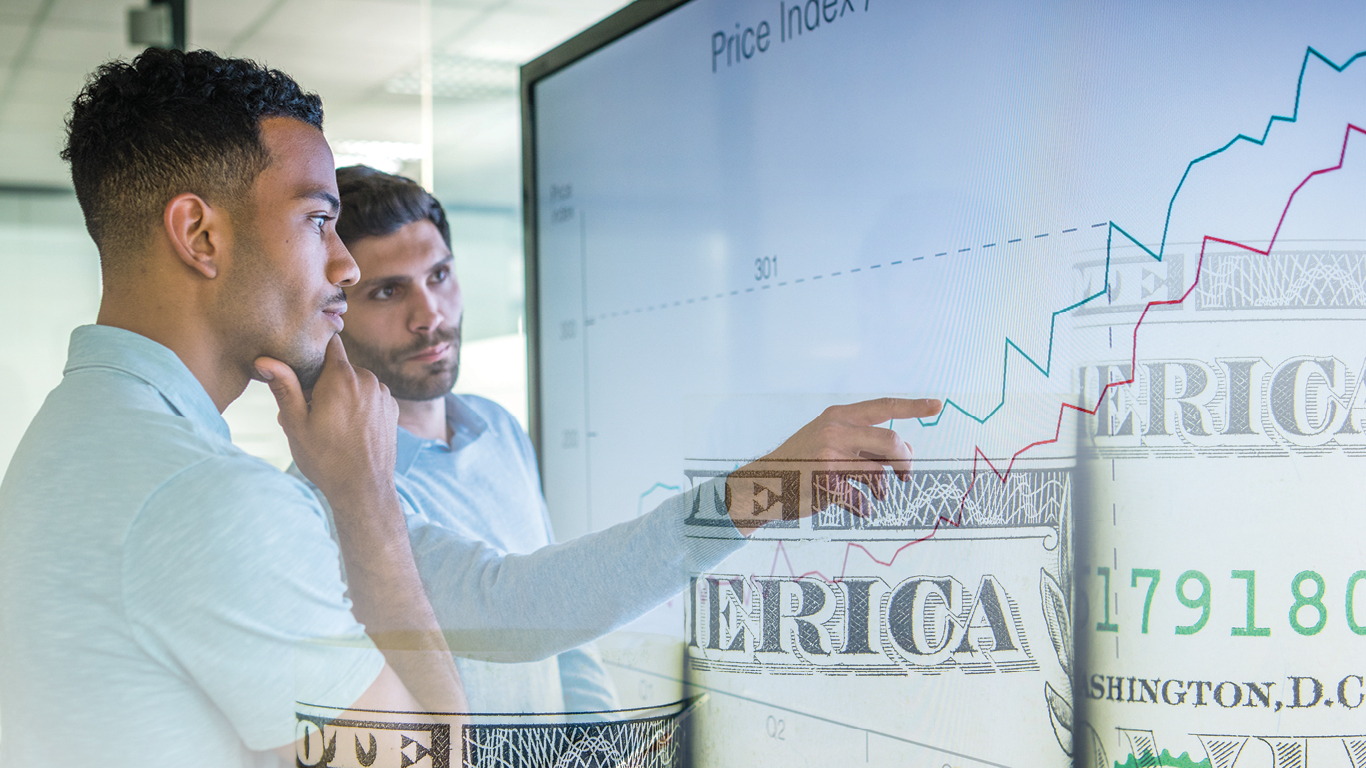 tow men viewing investments on a white board