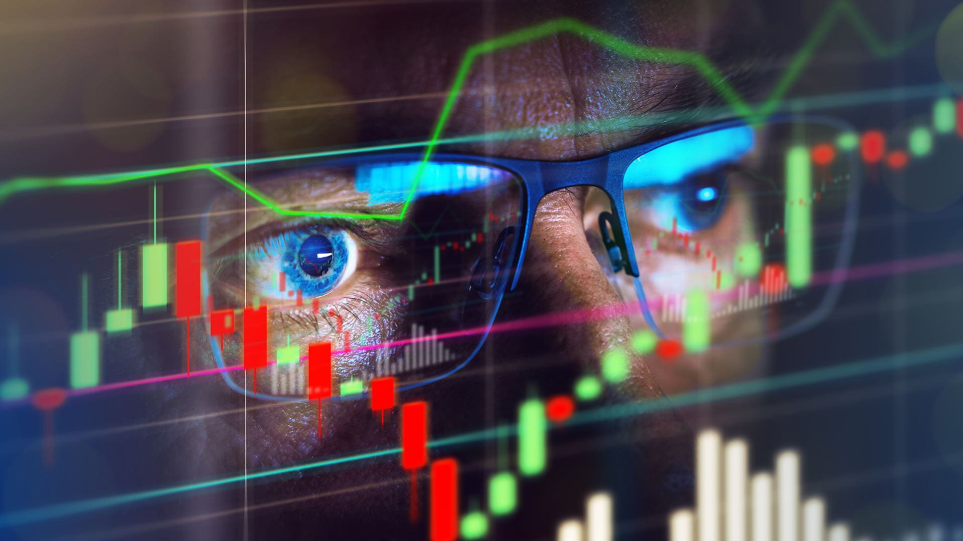 close up of a person's eyes watching stocks