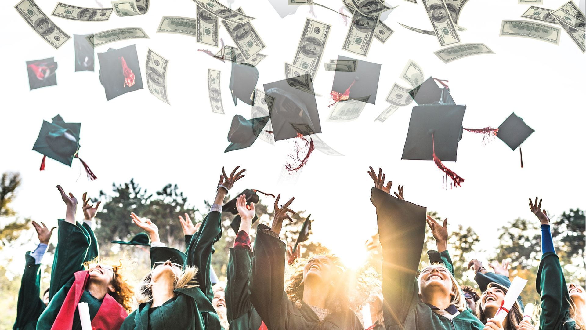 new graduates throwing their caps into the air