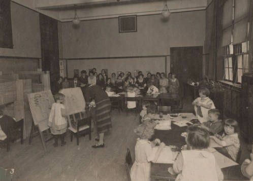 Student teachers, seated at the far end, observing a class at the campus elementary school. Student teachers could both observe, as well as get practical teaching experience in a real school setting
