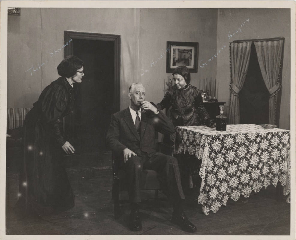 Will he drink the elderberry wine? The Brewster sisters certainly hope so! (My apologies, this is a favorite play, so I get a little excited about it.) From l-r: Thelma Sherman, English professor; Dr. Hawkins; Genevieve Heagney, Principal of the Campus Elementary School.