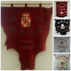 These class banners hang in the Archives. They showcase mottoes from various classes.