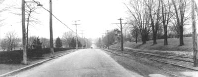 Looking north on York Road in front of campus. The streetcar line runs on the right side.
