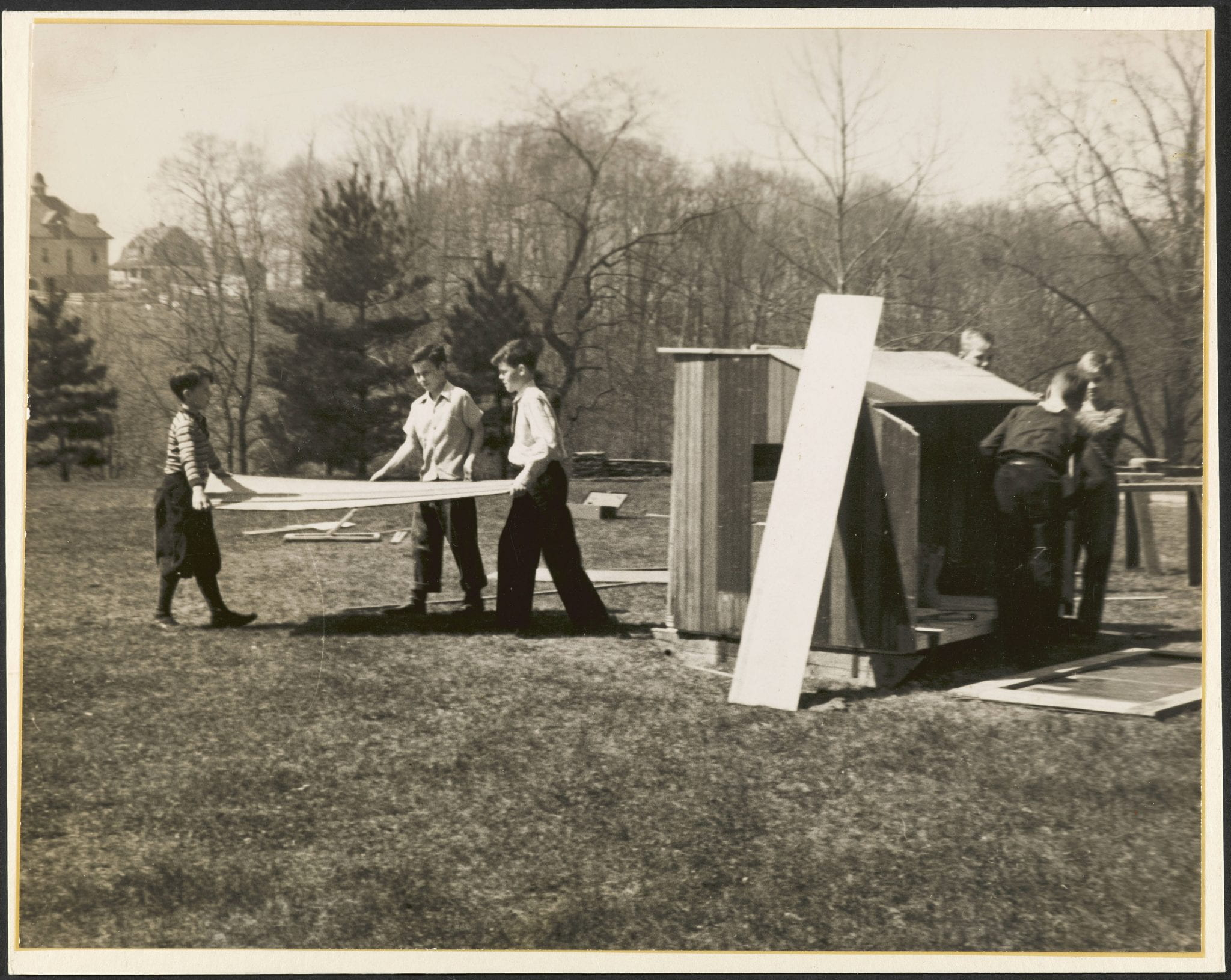 1930s students building a chicken coop.