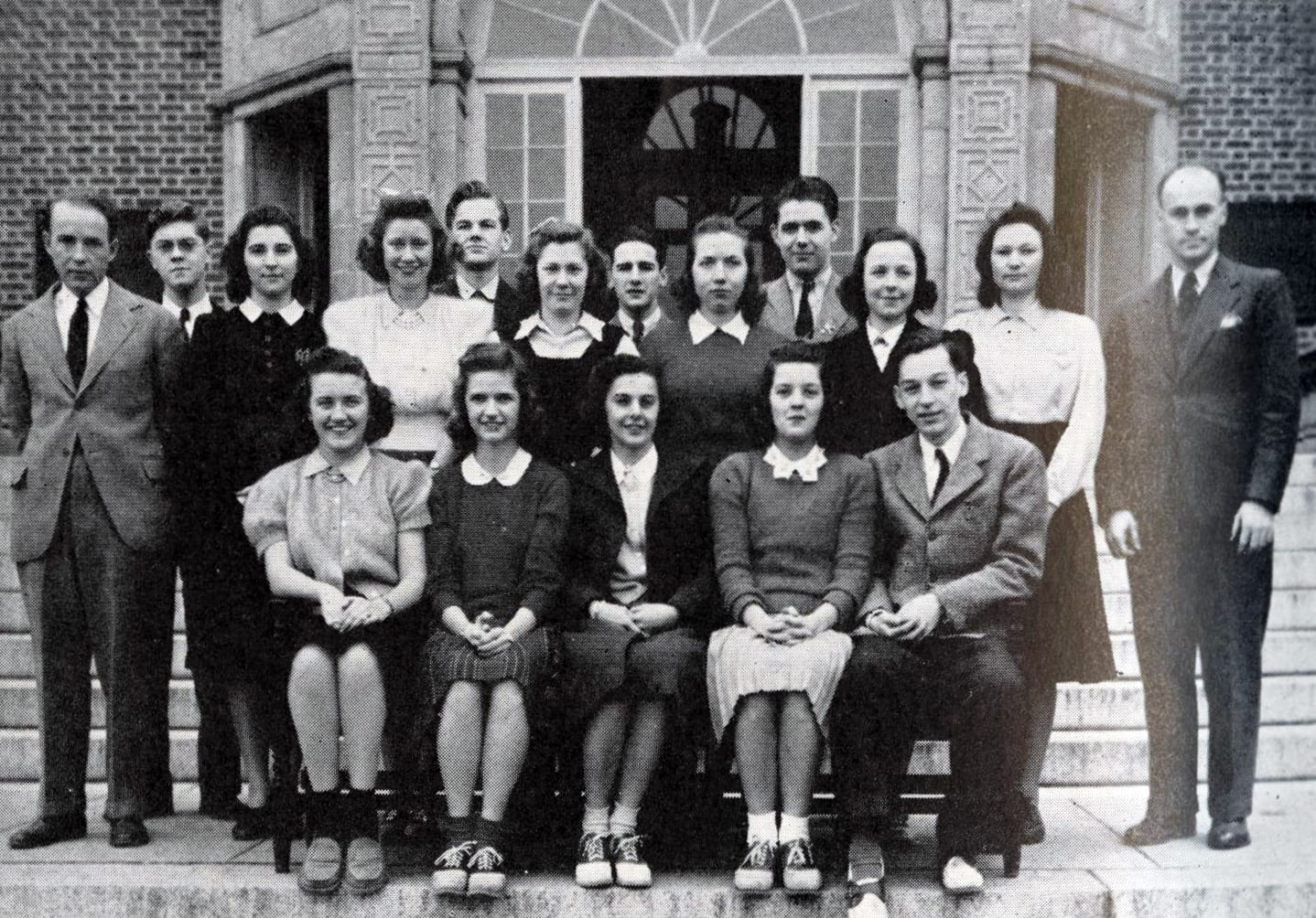 Photograph of 1941 Student Council members and faculty seated and standing on steps of Stephens Hall.