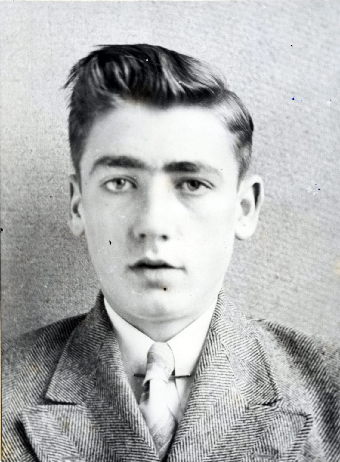 Photo of Robert Lytle dressed in a suit and tie.