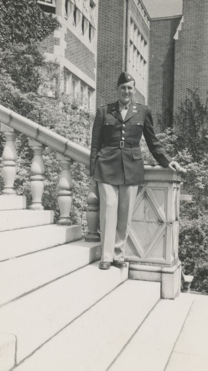 Photo of Norris in dress uniform standing on steps of Stephens Hall.