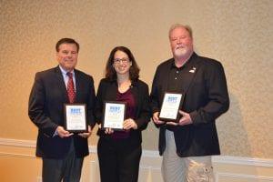 Massachusetts Water Resource Outreach Center Co-Director, Corey Denenberg Dehner (Center) accepts the 2016 Stormy Award.