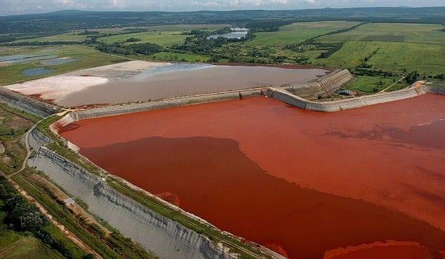 epa02373876 (FILE) An aerial photo taken on 24 August 2006 on a reservoir containing red mud of an alumina factory near Ajka, 156 kms southwest of Budapest, Hungary. A wall of the reservoir broke on 04 October 2010 and the poisonous chemical sludge inundated some 400 family houses in Devecser, killing one person and injuring some sixty. Three people are unaccounted for.  E  EPA/SANDOR H. SZABO HUNGARY OUT