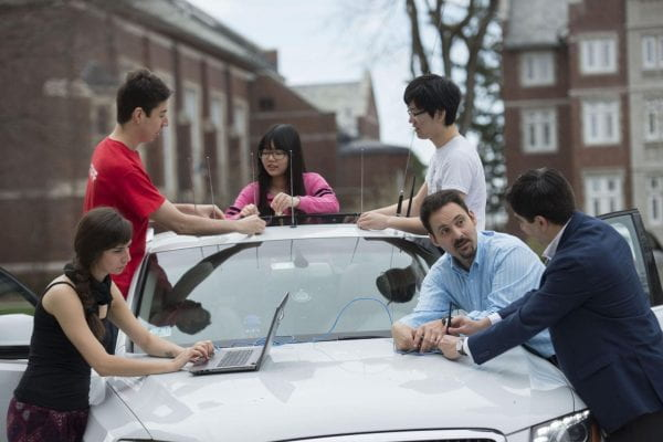 Wyglinski with his undergraduate and graduate students teaching them about connected vehicle technology
