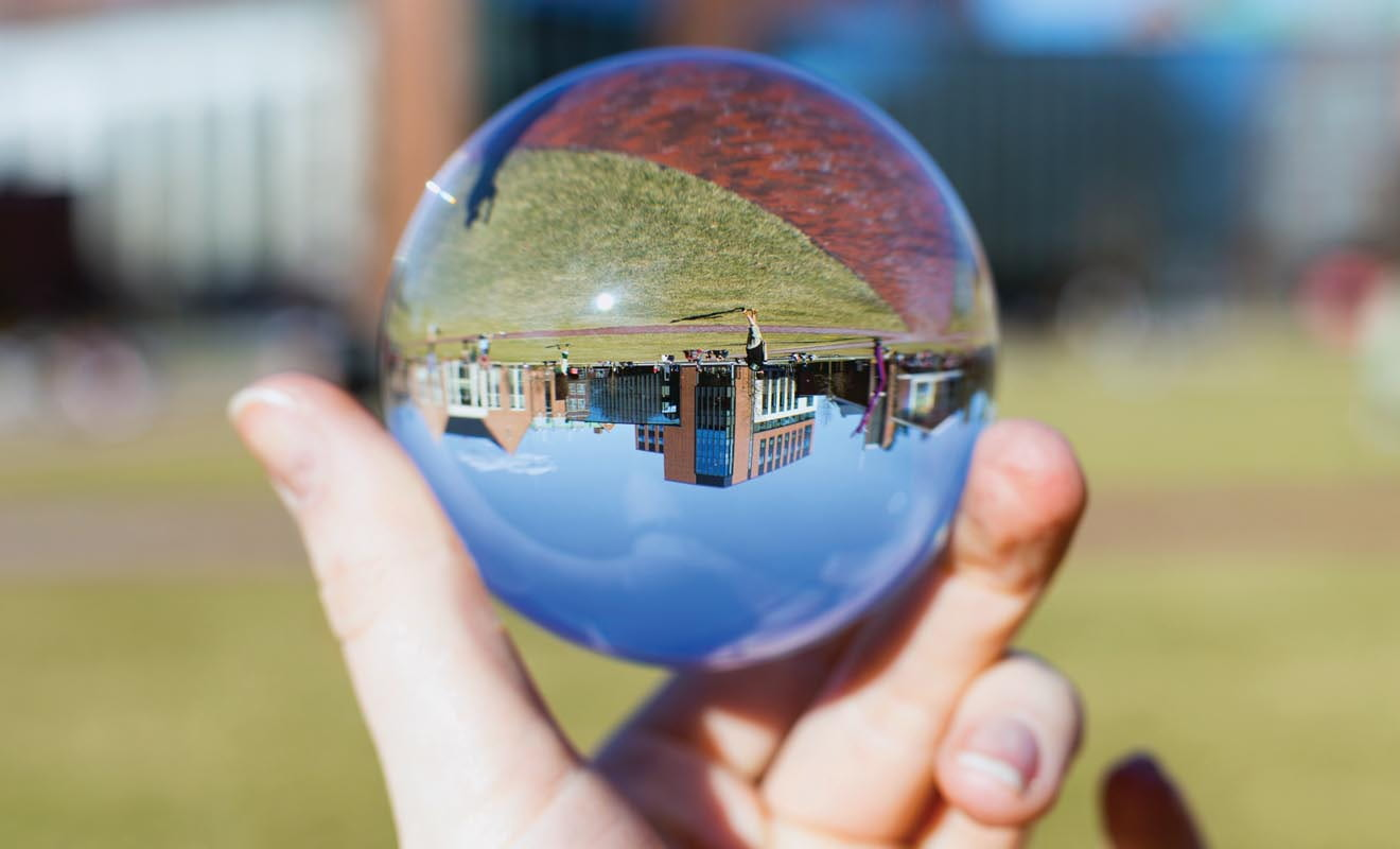 The WPI campus pictured upside down in globe.