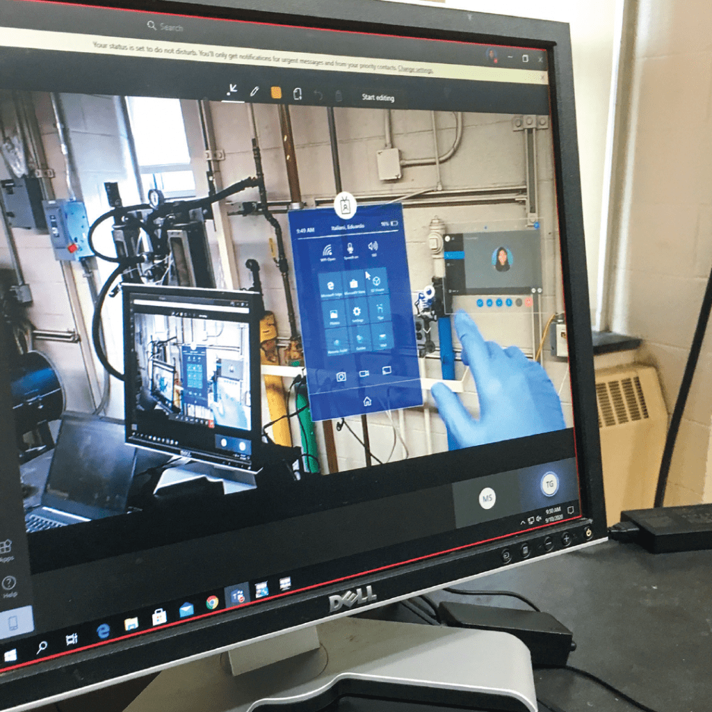 A computer monitor showing an augmented reality program that allows remote students to operate equipment in a chemical engineering lab
