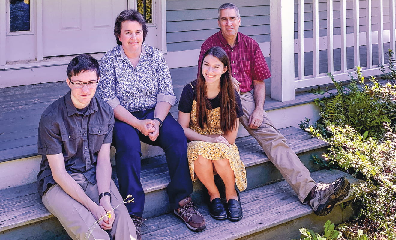 The Frey Family on the steps of their home in New Hampshire