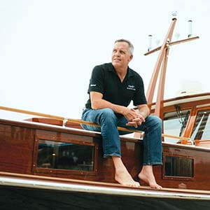 Wes Wheeler '78 sitting on his boat
