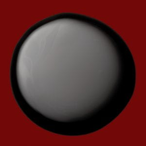 a circular, glossy black bit of makeup on a red background