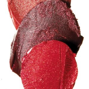 three overlapping chips of reddish make-up