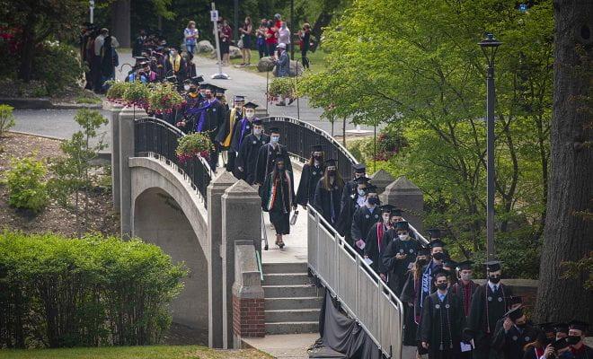 WPI Commencement graduates crossing Earle Bridge