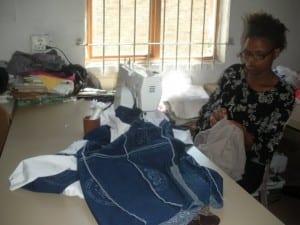 Woman sewing at Imiza Moyethu