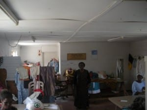 Nobandla stands in the Imiza Moyethu sewing centre