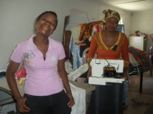 Our co-researcher, Bongi, (left) poses with a seamstress from Imiza Moyethu (right)