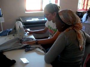 Kayla and Bongeka using the sewing machine