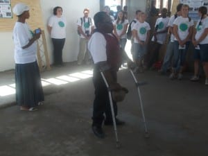 Tata Mbele leading prayer