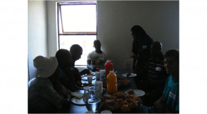 Shop owners eating after the focus group discussion