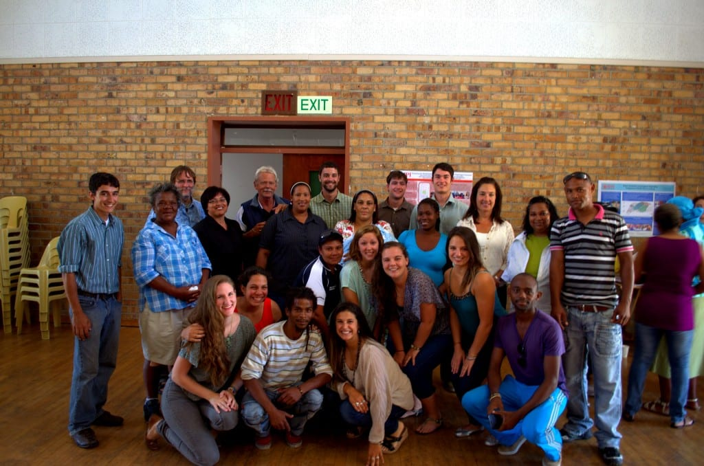 Members from the Flamingo Crescent community, CORC, ISN, City of Cape Town Informal Settlement Management department, WPI Advisors and students gathered for a picture after final presentations