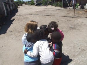 One of the students sharing pictures with the children of the settlement.