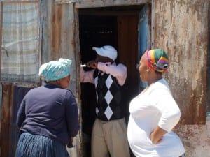 Xolani fixing Zoliuse's door