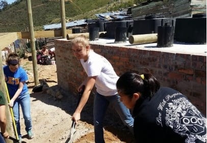 Tati, Rachel, and Jing working on the new facility