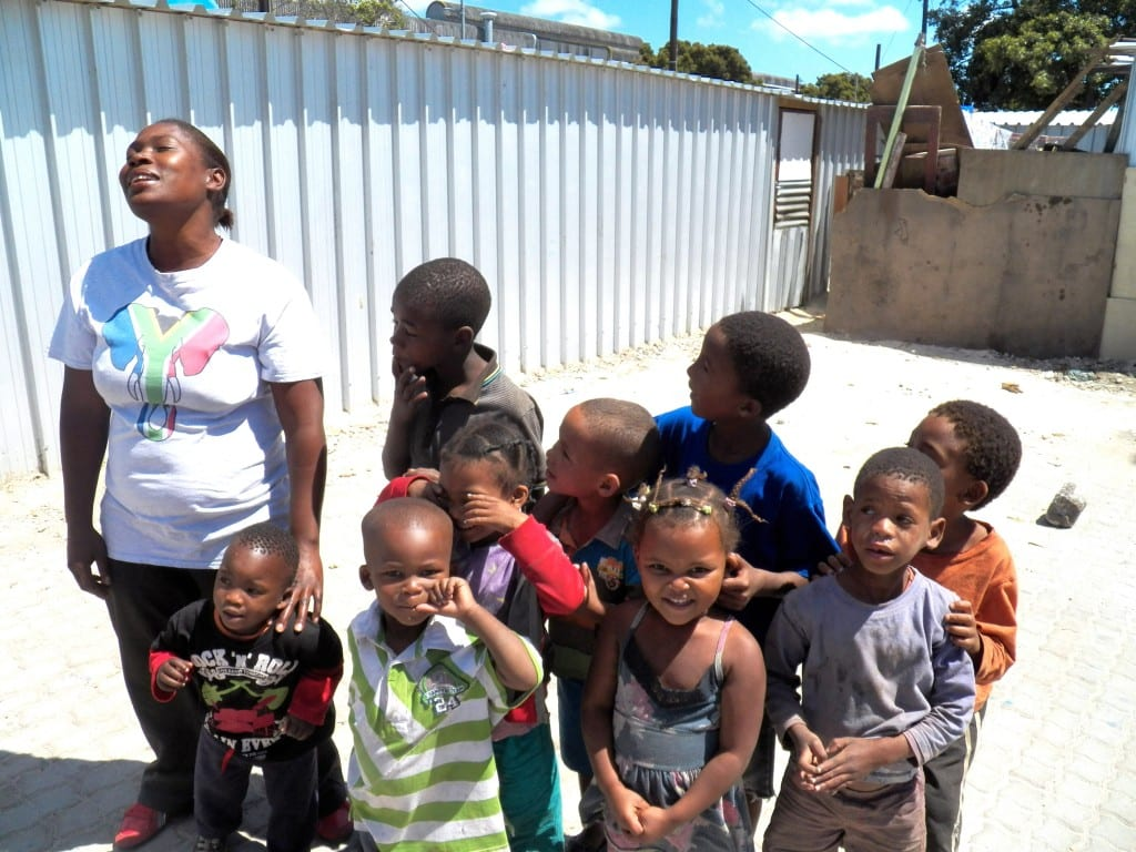 Community Leader Elizabeth Interacting with the Children