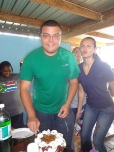 Reed cutting his birthday cake, with Mollie and Heather helping him celebrate (sorry Heather)!