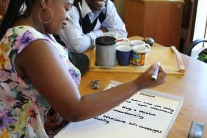 Fikiswa Taking Notes During a Mentor Meeting
