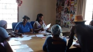 Fikiswa And Xolani Explaning The Worksheets To The Women