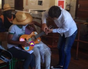 Edgar, a co-researcher, taught a Streetscapes participant how to play chords on the guitar.