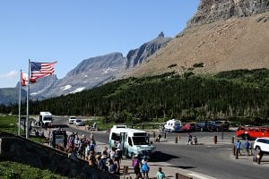 A line of visitors wait for the shuttles at Logan Pass in Glacier National Park on July 18, 2017. Greg Lindstrom | Flathead Beacon