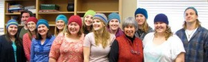 Cathy Wimett knits hats for her students.