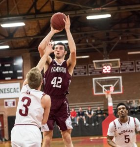 Freshman Tyus Ripley puts up a shot at a recent game against Bates College. (Photo by Jeff Lamb Photography)