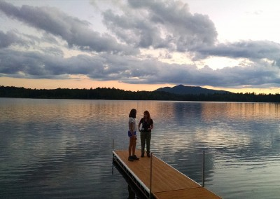 Two students on the end of a dock